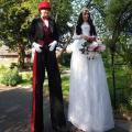 Bride and Groom stilt walkers